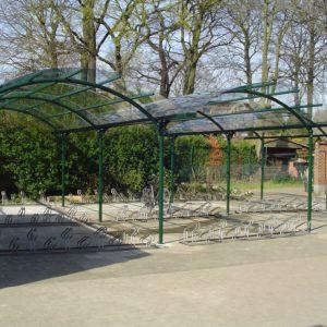 BOzARC double arrondi, parking deux roues, structure vert, toiture transparente.